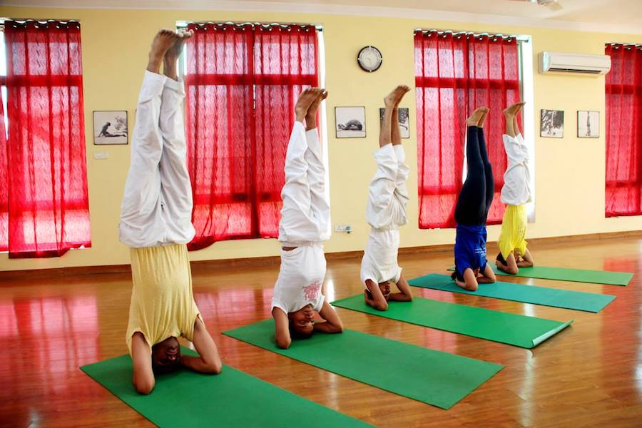 "<div style=""font-family: catamaran; color:#3c2c1e"">Sivananda Yoga Vedanta Centre</br><span style=""font-size: .8em"">New Delhi West, Dwarka 